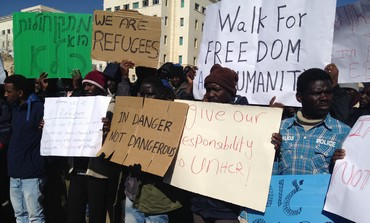 African migrants and their supporters rallying ouside the Prime Minister's office in Jerusalem.