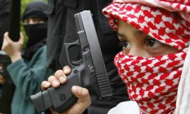 Palestinian fighters of the Fatah al-Islam group undergo military training with children.