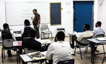 Haredi men attend an English lesson in the ultra-Orthodox town of Elad.