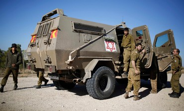 IDF medics at the scene of the shooting on the northern Gaza border, December 24, 2013.