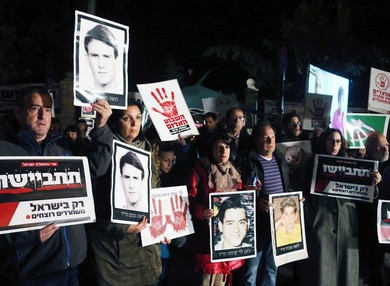 Bereaved family members protest against an impending release of Palestinian prisoners.