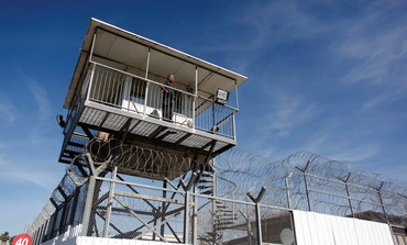 A guard keeps watch from a tower at Ayalon Prison in Ramle.
