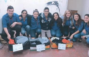 Israeli teenagers gather clothes for victims of the Syrian civil war.