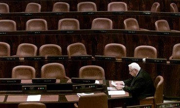 Ariel Sharon alone at the Knesset [file].