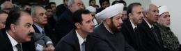 Syrian President Bashar Assad attends prayers marking the birth of the Prophet Muhammed