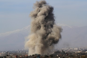 Smoke after alleged Barrel-bomb explosion in Syria, January 31, 2014