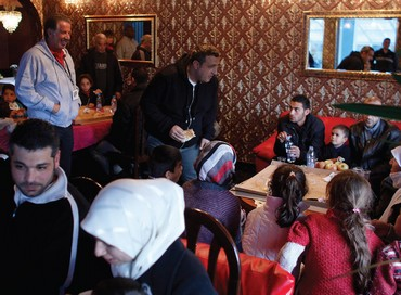 Yank Barry (left standing) with Syrian refugees in Bulgaria.