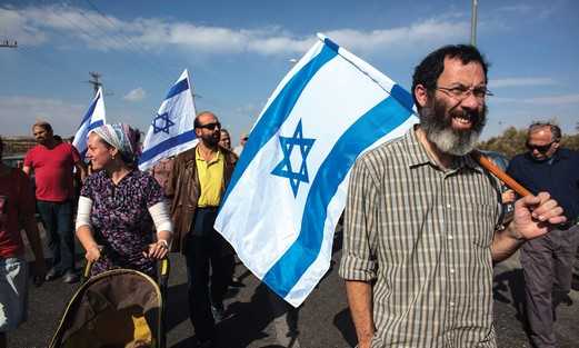 Settlers hold a protest close to the scene of an attack by Palestinians near a West Bank settlement