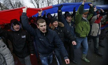 Pro-Russian supporters in Ukraine attend a rally in the Crimea.