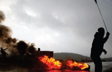 Palestinians confront Israeli troops at the West Bank village of Silwad, near Ramallah, on January 1