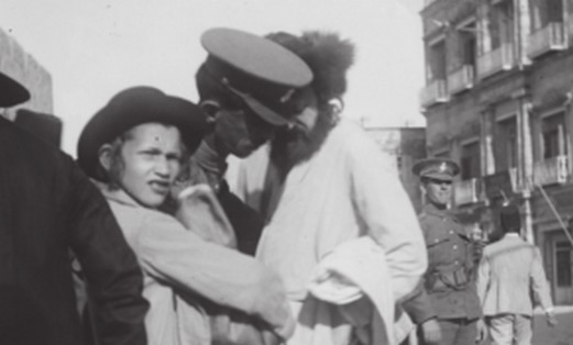 BRITISH POLICE officers corral Jewish men during the 1920 Jerusalem riots
