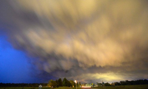 A low-level thunderstorm supercell passes over the area of Hampton, Arkansas late April 24, 2014
