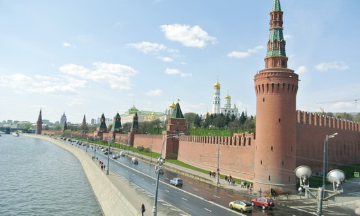 THE KREMLIN'S medieval turrets line the Moskva River
