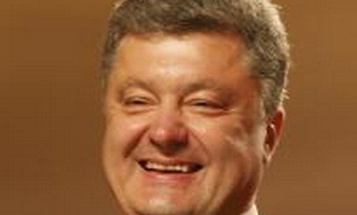 Ukrainian businessman, politician and presidential candidate Petro Poroshenko smiles as he speaks to