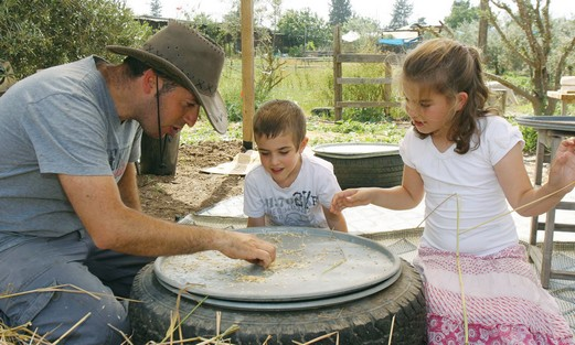 CHILDREN EXAMINE wheat at the Gilad Farm.
