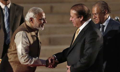 India's Prime Minister Narendra Modi (L) is greeted by his Pakistani counterpart Nawaz Sharif