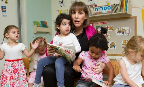 Livnat with children at daycare.