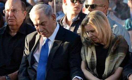 PM Binyamin Netanyahu and his wife Sara, with Defence Minister Moshe Yaalon at the funeral of the three boys
