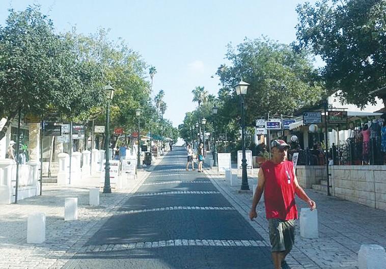 A MAN walks down a street in Zichron Ya'acov yesterday