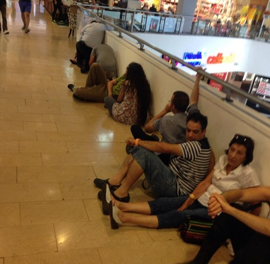 People at Dizengoff Center waiting for the all clear