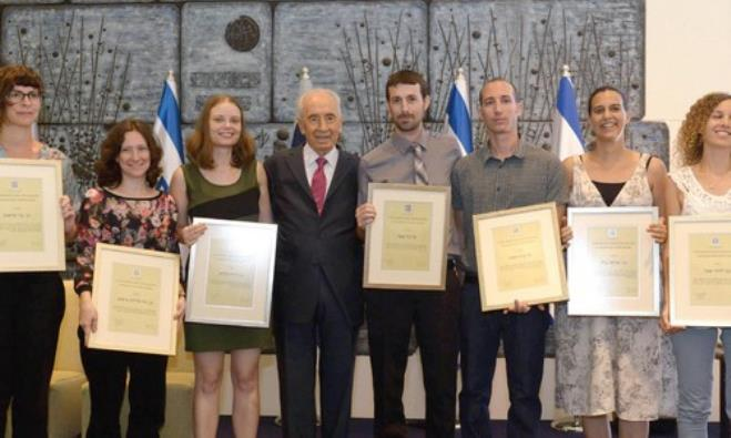 Peres with award recipients