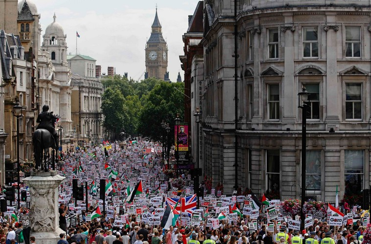 Demonstrators march in central London July 19