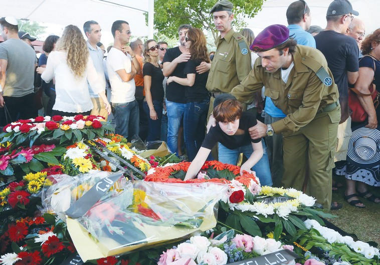 ORI GREENBERG, 13, mourns at the grave of his father, Maj. Amotz Greenberg, at his funeral