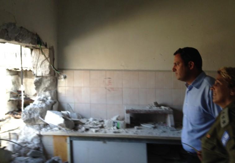 Sderot Mayor Alon Davidi with soldier in damaged building