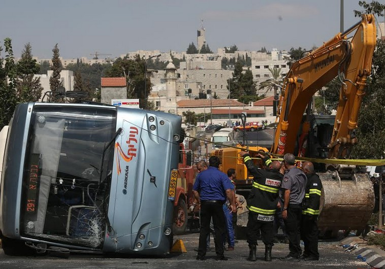 Bus flipped by tractor in Jerusalem terror attack