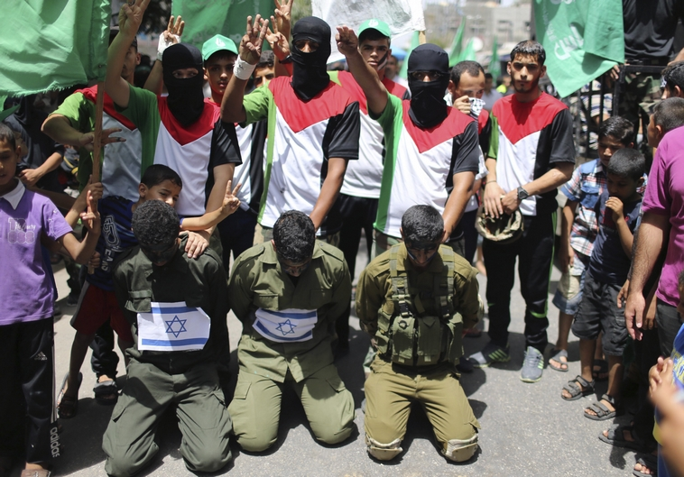 Hamas supporters reenact kidnapping of Israeli soldiers