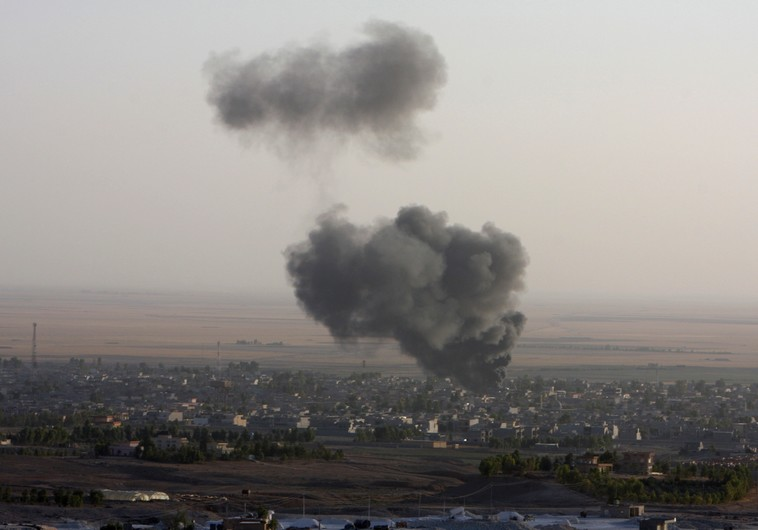 Smoke billows from the town of Makhmur during clashes between Iraqi Kurdish Peshmerga troops and Isl