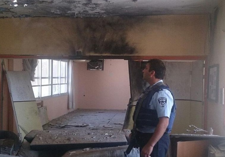 Police surveying damage of building in Eshkol, August 21, 2014.