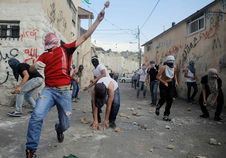 Analysis: Should Palestinian parents pay for minors' rock-throwing?