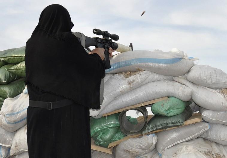 Veiled woman shoots gun