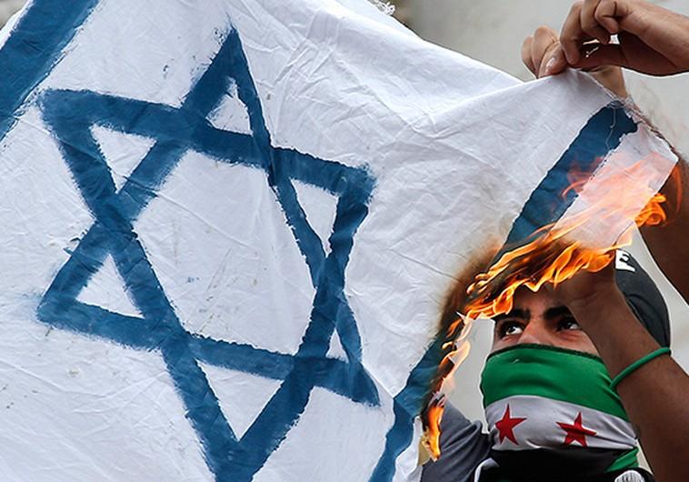Parisians burn an Israeli flag