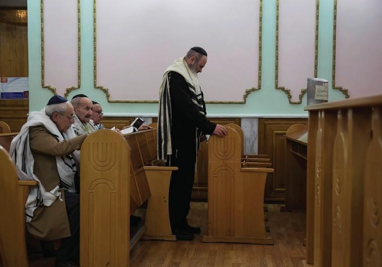 JEWS ATTEND the morning prayer