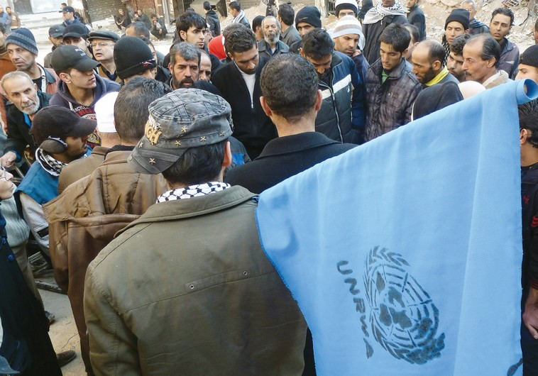 A man with an UNRWA flag in the southern Gaza Strip.