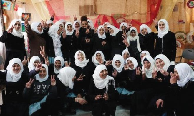 JANET JACKSON posted pictures of herself on Twitter visiting Yatta High School near Hebron.