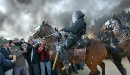 Mounted Israeli police scuffle with pro-settler supporters at the Amona outpost, February 1, 2006