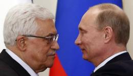 Russian President Vladimir Putin (R) and Palestinian Authority chief Mahmoud Abbas in Moscow