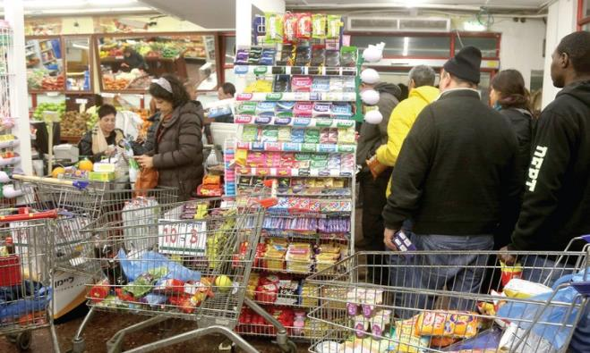 JERUSALEMITES STOCK UP on essentials yesterday, in anticipation of a tempest.