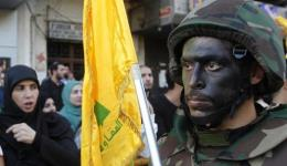 Lebanese Hezbollah supporters march during a religious procession