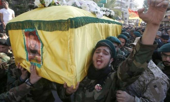 Hezbollah members react while carrying the coffin of Abbas Hijazi, who died in an airstrike