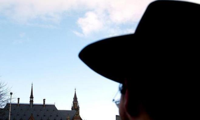 A Jewish man gazes at the Peace Palace in The Hague