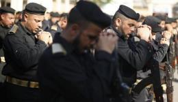 Members of Palestinian security forces loyal to Hamas turn their weapons during a parade