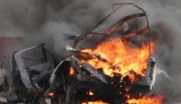 A burnt vehicle is seen near the village of Ghajar on Israel