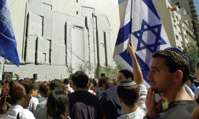 MEMBERS OF the Argentine Jewish community congregate in front of the former Israeli embassy