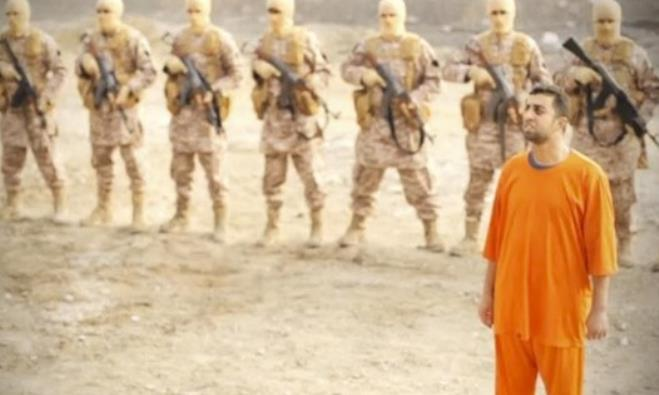 A man purported to be Islamic State captive Jordanian pilot Muath al-Kasaesbeh (in orange jumpsuit)