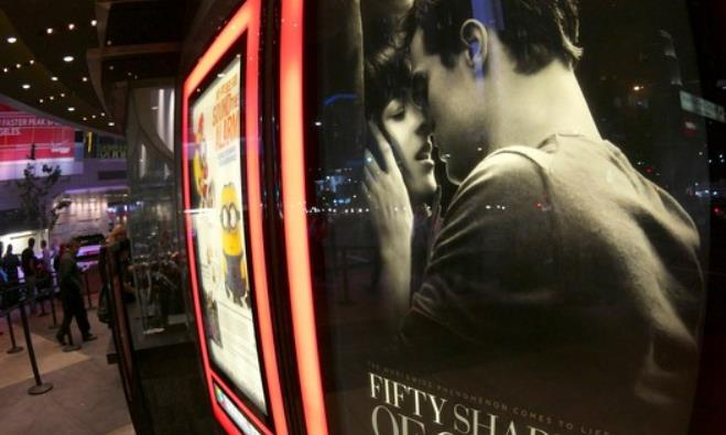 "A film poster for ""Fifty Shades of Grey"" is pictured at Regal Theater in Los Angeles"