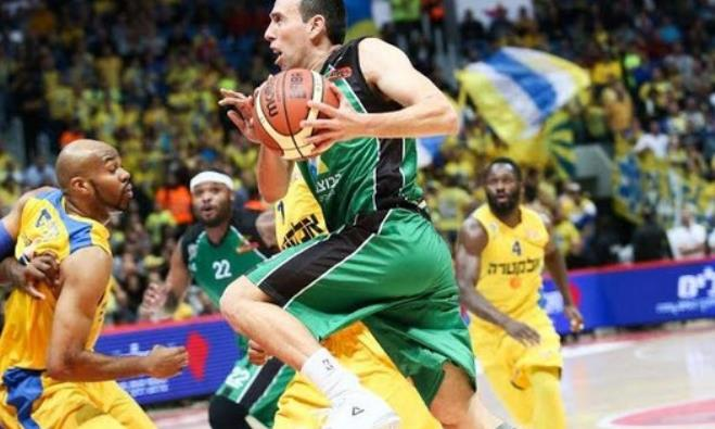 Maccabi Haifa guard Moran Roth drives to the basket